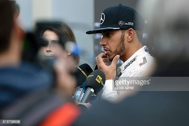 Mercedes AMG Petronas F1 Team's British driver Lewis Hamilton talks with journalists at the Circuit de Catalunya on March 4 2016 in Montmelo on the...