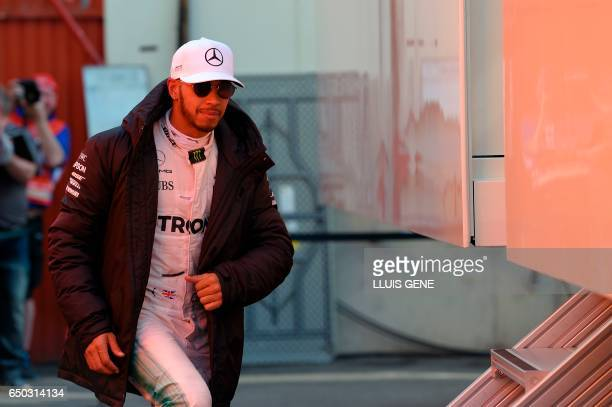 Mercedes AMG Petronas F1 Team's British driver Lewis Hamilton walks at the Circuit de Catalunya on March 9 2017 in Montmelo on the outskirts of...