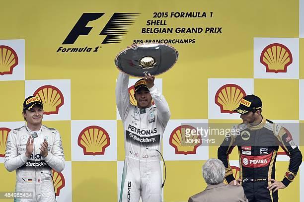 Mercedes AMG Petronas F1 Team's British driver Lewis Hamilton celebrates winning next to second placed Mercedes AMG Petronas F1 Team's German driver...