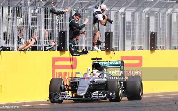 Mercedes AMG Petronas F1 Team's British driver Lewis Hamilton celebrates winning the Hungarian Formula One Grand Prix on July 24 2016 at the...