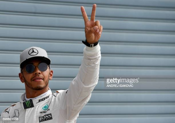 TOPSHOT Mercedes AMG Petronas F1 Team's British driver Lewis Hamilton celebrates winning the pole position in the qualifying session at the Autodromo...