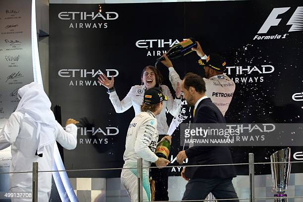 Mercedes AMG Petronas F1 Team's German driver Nico Rosberg and his Mercedes AMG Petronas teammate British driver Lewis Hamilton celebrate with a team...