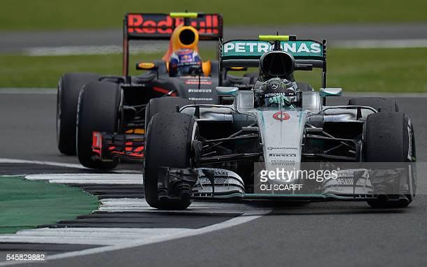 Mercedes AMG Petronas F1 Team's German driver Nico Rosberg and Infiniti Red Bull racing's BelgianDutch driver Max Verstappen drive near the end of...