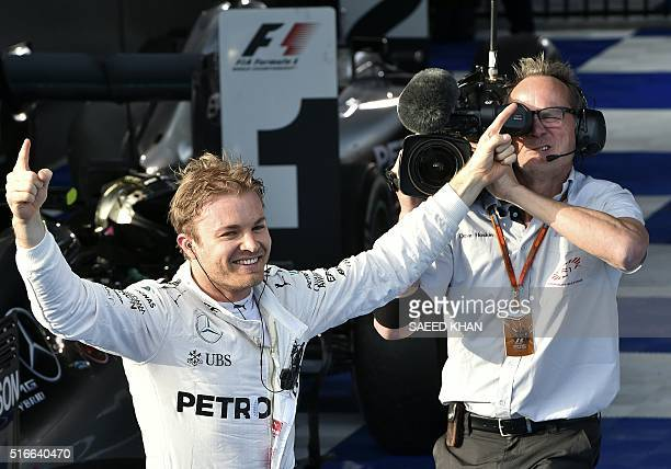 Mercedes AMG Petronas F1 Team's German driver Nico Rosberg celebrates after winning the Formula One Australian Grand Prix in Melbourne on March 20,...