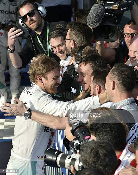 Mercedes AMG Petronas F1 Team's German driver Nico Rosberg celebrates with his team members after winning the Formula One Australian Grand Prix in...