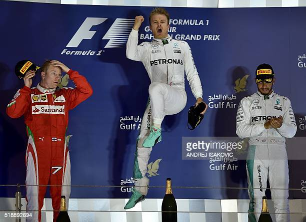 Mercedes AMG Petronas F1 Team's German driver Nico Rosberg celebrates on the podium after winning the Bahrain Formula One Grand Prix next to second...