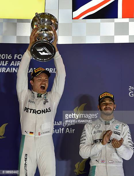 Mercedes AMG Petronas F1 Team's German driver Nico Rosberg celebrates on the podium with the trophy after winning the Bahrain Formula One Grand Prix...