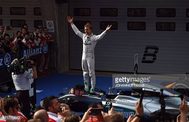 TOPSHOT Mercedes AMG Petronas F1 Team's German driver Nico Rosberg celebrates after winning the Formula One Chinese Grand Prix in Shanghai on April...