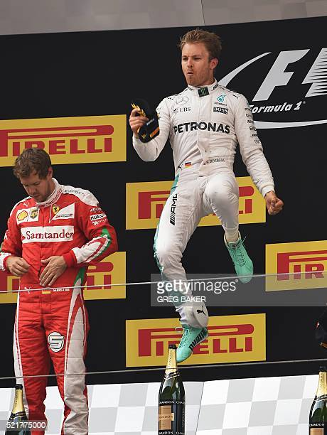 Mercedes AMG Petronas F1 Team's German driver Nico Rosberg celebrates on the podium after winning the Formula One Chinese Grand Prix in Shanghai on...