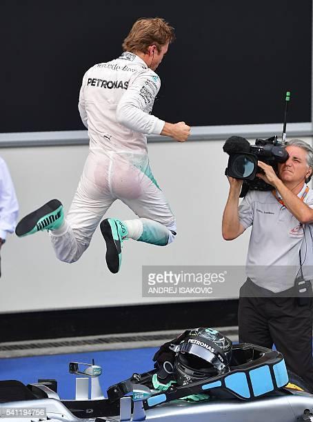 Mercedes AMG Petronas F1 Team's German driver Nico Rosberg celebrates after winning the European Formula One Grand Prix at the Baku City Circuit on...