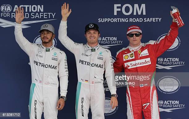 Mercedes AMG Petronas F1 Team's German driver Nico Rosberg celebrates after taking pole position ahead of teammate Mercedes AMG Petronas F1 Team's...