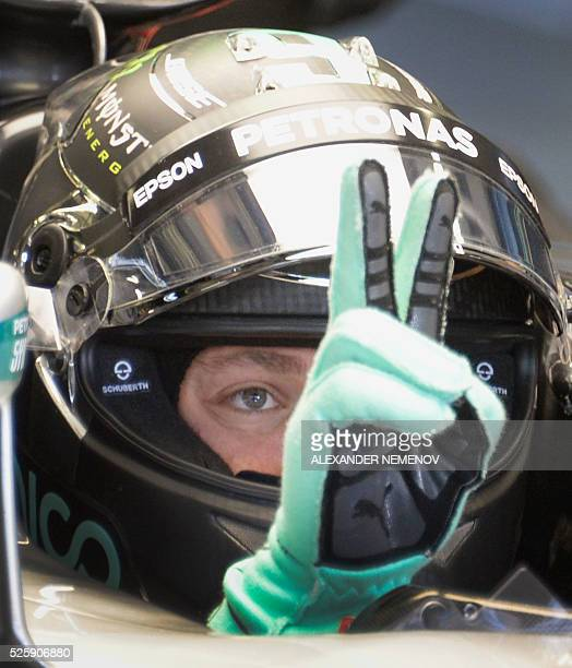 Mercedes AMG Petronas F1 Team's German driver Nico Rosberg gestures as he sits in his car during the first practice session of the Formula One...