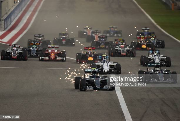 TOPSHOT Mercedes AMG Petronas F1 Team's German driver Nico Rosberg leads at the start of the Bahrain Formula One Grand Prix at the Sakhir circuit in...