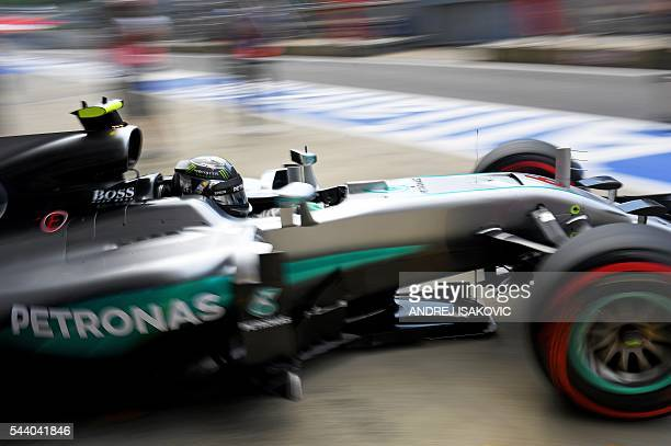 TOPSHOT Mercedes AMG Petronas F1 Team's German driver Nico Rosberg leaves the box during the first practice session of the Formula One Grand Prix of...