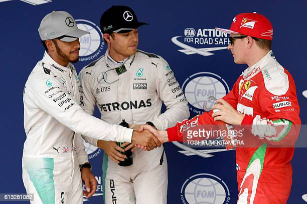 Mercedes AMG Petronas F1 Team's German driver Nico Rosberg looks on after taking pole position ahead of teammate Mercedes AMG Petronas F1 Team's...