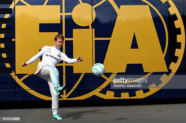 TOPSHOT Mercedes AMG Petronas F1 Team's German driver Nico Rosberg plays with a ball before the first practice session of the Formula One Grand Prix...