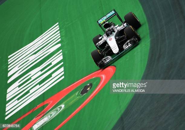 TOPSHOT Mercedes AMG Petronas F1 Team's German driver Nico Rosberg powers his car during the qualifying session for Sunday's Brazilian Grand Prix in...