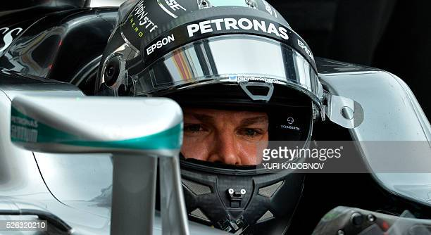 Mercedes AMG Petronas F1 Team's German driver Nico Rosberg sits in his car during the third practice session of the Formula One Russian Grand Prix at...