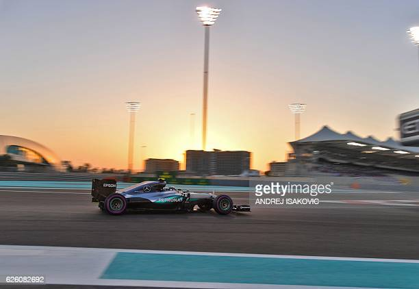 TOPSHOT Mercedes AMG Petronas F1 Team's German driver Nico Rosberg steers his car during the Abu Dhabi Formula One Grand Prix at the Yas Marina...