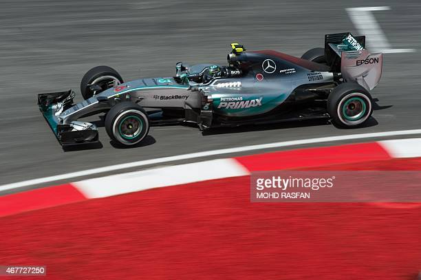Mercedes AMG Petronas F1 Team's German driver Nico Rosberg takes a corner during the second practice session at the Formula One Malaysian Grand Prix...