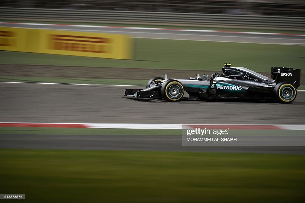 TOPSHOT - Mercedes AMG Petronas F1 Team's German driver Nico Rosberg takes the lead during the Bahrain Formula One Grand Prix at the Sakhir circuit in Manama on April 3, 2016.
