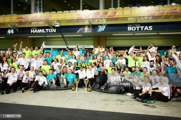 Mercedes AMG Petronas F1 Teams pose for a team photo after the Abu Dhabi F1 Grand Prix race at the Yas Marina Circuit in Abu Dhabi.