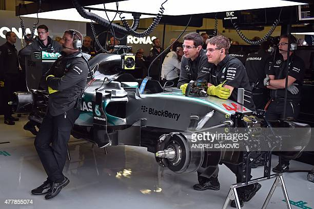 Mercedes AMG Petronas F1 Team's technicians watch the screens at the pits during the third practice session at the Red Bull Ring in Spielberg on June...