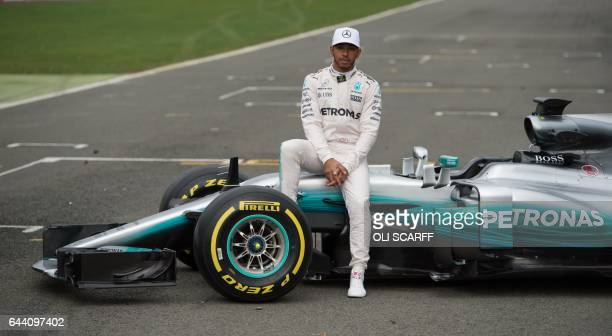 TOPSHOT Mercedes AMG Petronas Formula One driver Britain's Lewis Hamilton poses by the new 2017 season Mercedes W08 EQ Power Formula One car at its...