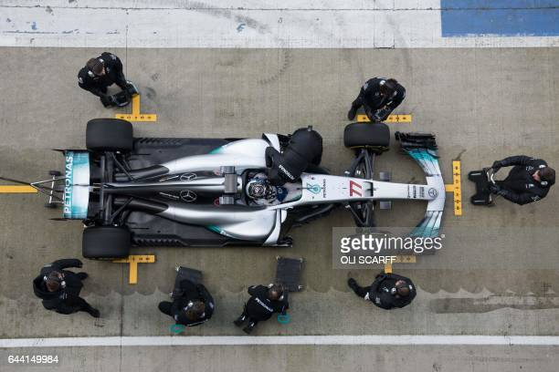TOPSHOT Mercedes AMG Petronas Formula One driver Finland's Valtteri Bottas drives during a launch event for the new 2017 season car at the...
