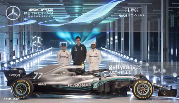 TOPSHOT Mercedes AMG Petronas Formula One drivers Finland's Valtteri Bottas and Britain's Lewis Hamilton with Mercedes AMG Petronas Formula One Team...