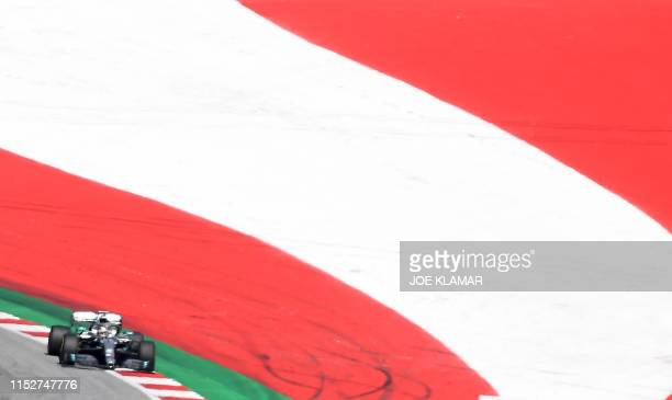TOPSHOT Mercedes AMG's British driver Lewis Hamilton races the qualifying session of the Austrian Formula One Grand Prix in Spielberg on June 29 2019...
