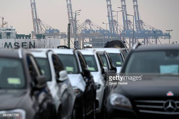 Mercedes and BMW cars destined for export overseas stand parked and waiting to be loaded onto ships on January 22 2014 in Bremerhaven Germany...