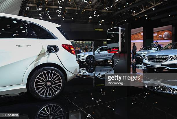 Mercedes B250e electric automobile, manufactured by Mercedes-Benz AG, sits connected to a charging station during the second press day of the Paris...