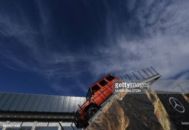 A Mercedes Benz Gclass Wagon is driven down a 42 degrees slope on a hill course at the 2017 LA Auto Show in Los Angeles California on November 30...