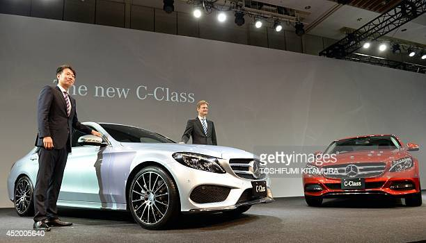 Mercedes Benz Japan president Kintaro Ueno and vice president Marc Boderke pose beside the company's new C-class sedan during its press preview in...