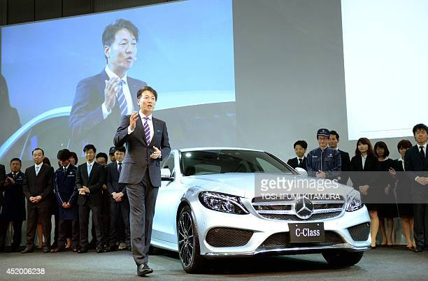 Mercedes Benz Japan president Kintaro Ueno introduces the company's new C-class sedan with company employees during its press preview in Tokyo on...