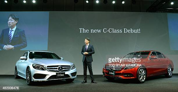 Mercedes Benz Japan president Kintaro Ueno speaks as he introduces the company's new C-class sedan during its press preview in Tokyo on July 11,...