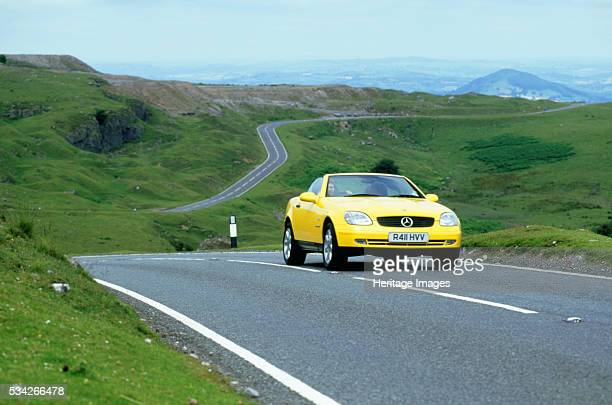 Mercedes Benz SLK 230 driving on country road in Wales 2000