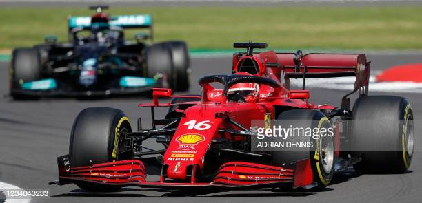 Mercedes' British driver Lewis Hamilton and Ferrari's Monegasque driver Charles Leclerc drive during the Formula One British Grand Prix motor race at...