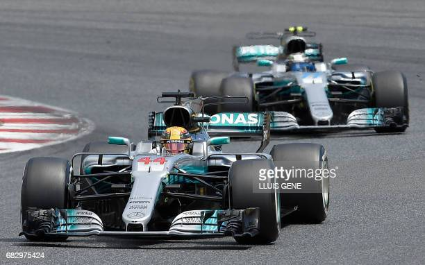Mercedes' British driver Lewis Hamilton and Mercedes' Finish driver Valtteri Bottas race at the Circuit de Catalunya on May 14 2017 in Montmelo on...