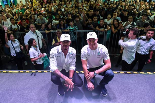 Mercedes british driver lewis hamilton l and mercedes finnish mercedes british driver lewis hamilton l and mercedes finnish driver valtteri bottas r pose for pictures during a meet the fans session in kuala m4hsunfo