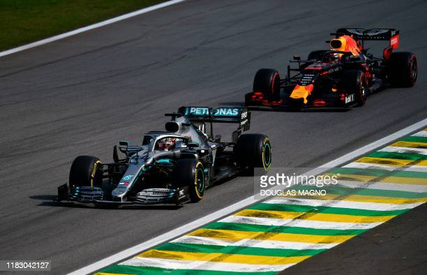 Mercedes' British driver Lewis Hamilton and Red Bull's Dutch driver Max Verstappen power their cars during the F1 Brazil Grand Prix at the Interlagos...