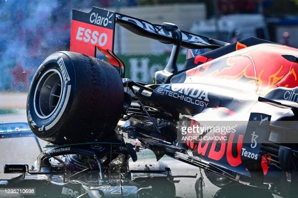 Mercedes' British driver Lewis Hamilton and Red Bull's Dutch driver Max Verstappen collide during the Italian Formula One Grand Prix at the Autodromo...