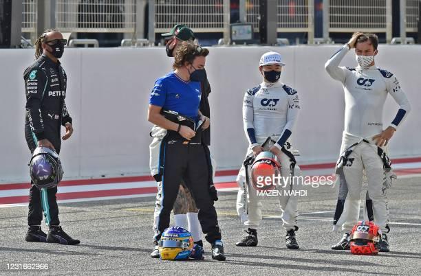 Mercedes' British driver Lewis Hamilton , Aston Martin's German driver Sebastian Vettel , Alpine's Spanish driver Fernando Alonso AlphaTauri's...