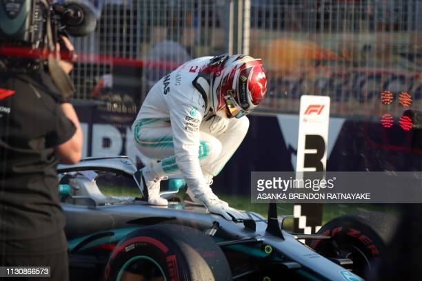TOPSHOT Mercedes' British driver Lewis Hamilton celebrates after taking the pole position in the Formula One qualifying session in Melbourne on March...