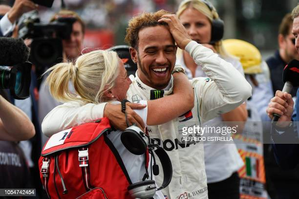 TOPSHOT Mercedes' British driver Lewis Hamilton celebrates after winning his fifth drivers' title during the F1 Mexico Grand Prix at the Hermanos...