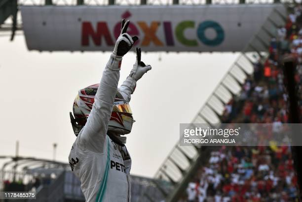 Mercedes' British driver Lewis Hamilton celebrates after winning the F1 Mexico Grand Prix at the Hermanos Rodriguez racetrack in Mexico City on...