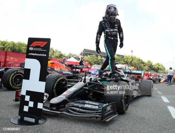 Mercedes' British driver Lewis Hamilton celebrates after winning the Spanish Formula One Grand Prix at the Circuit de Catalunya in Montmelo near...