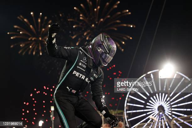 Mercedes' British driver Lewis Hamilton celebrates after winning the Bahrain Formula One Grand Prix at the Bahrain International Circuit in the city...