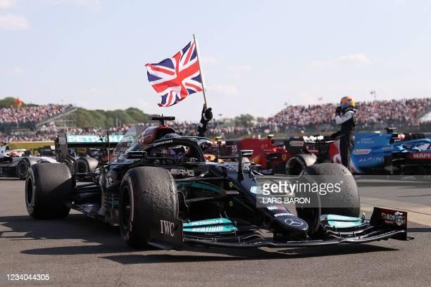 Mercedes' British driver Lewis Hamilton celebrates after winning the Formula One British Grand Prix motor race at Silverstone motor racing circuit in...